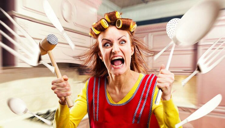 Scary woman with hair rollers surrounded by flying utensils