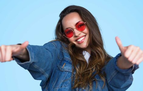 Optimistic woman sees the world through rose colored glasses