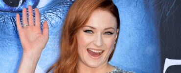 Sophie Turner smiles during the season seven premiere for Game of Thrones