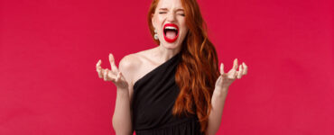 Frustrated woman on red background