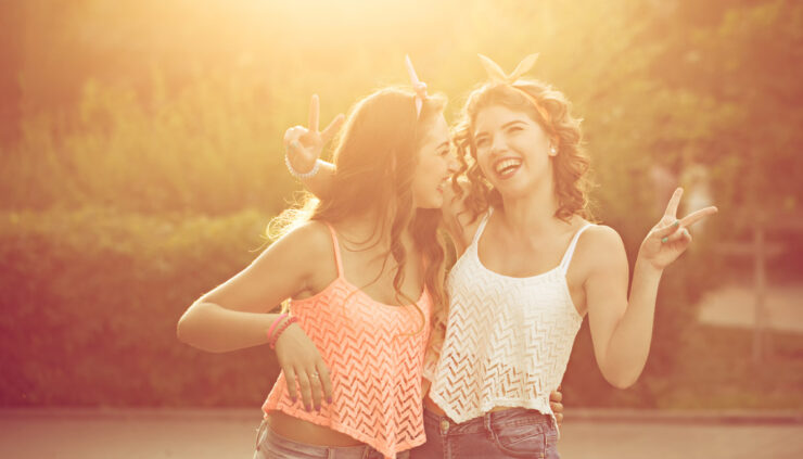 Two girls in pinup clothes laugh together
