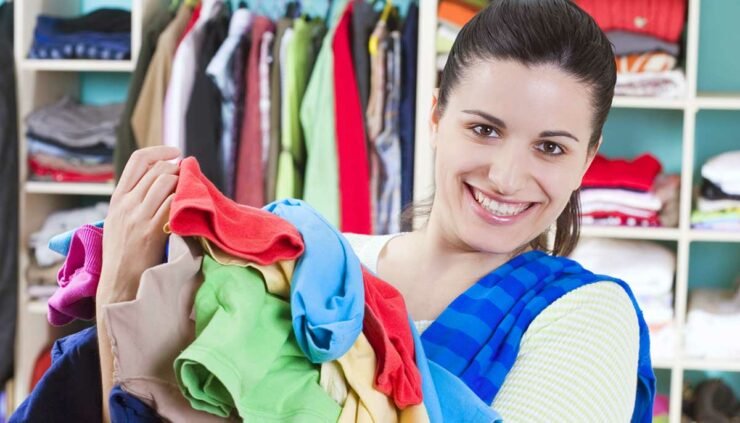 a woman cleaning out her closet