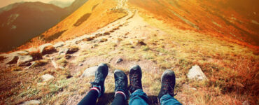 Feet of couple on mountaintop