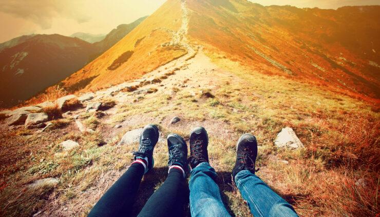 Feet of couple on mountaintop