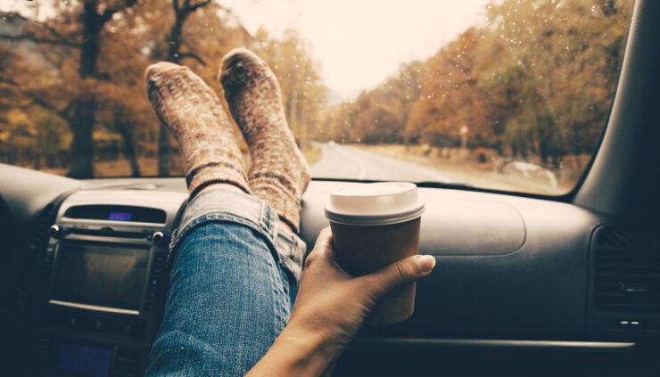 Woman's feet on the dashboard