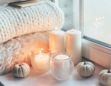 Cozy room with candles and blankets
