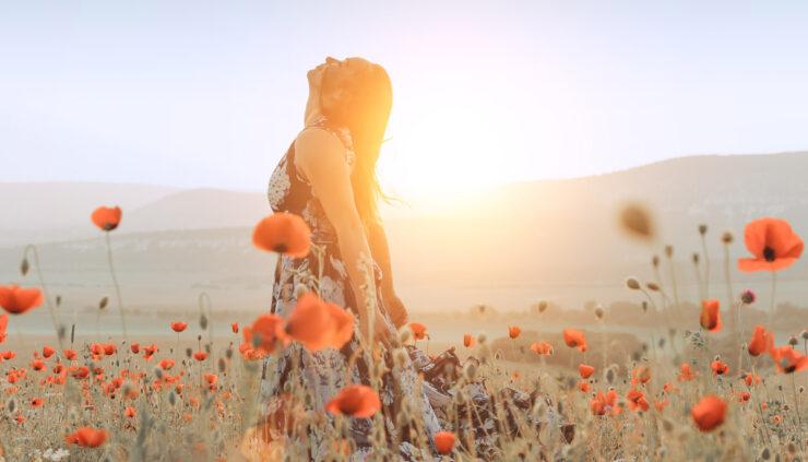 Girl in field of poppies