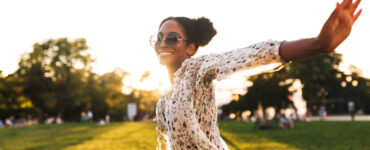 Black woman dancing in a field