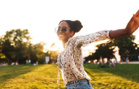 Black woman dancing in a field