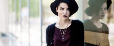 Woman with dark lipstick and hat