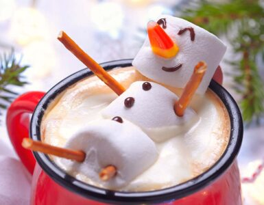 Happy snowman in a mug of hot chocolate