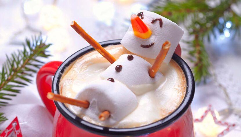 Happy snowman in a mug of hot chocolate
