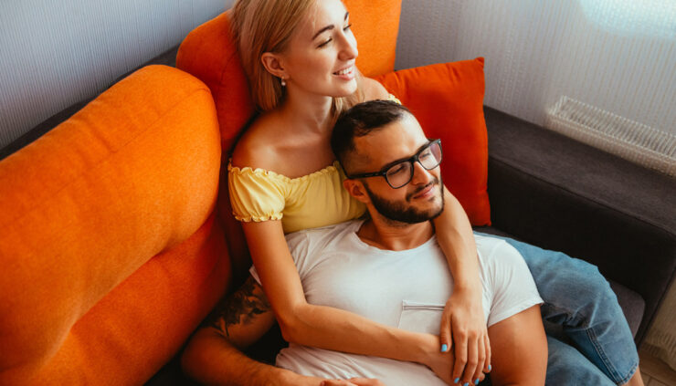Couple cuddling on couch
