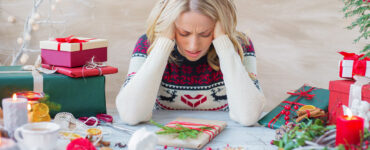 stressed out woman during Christmas gift prep