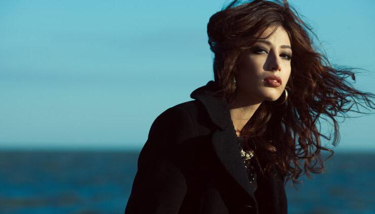 Melancholy woman in front of ocean