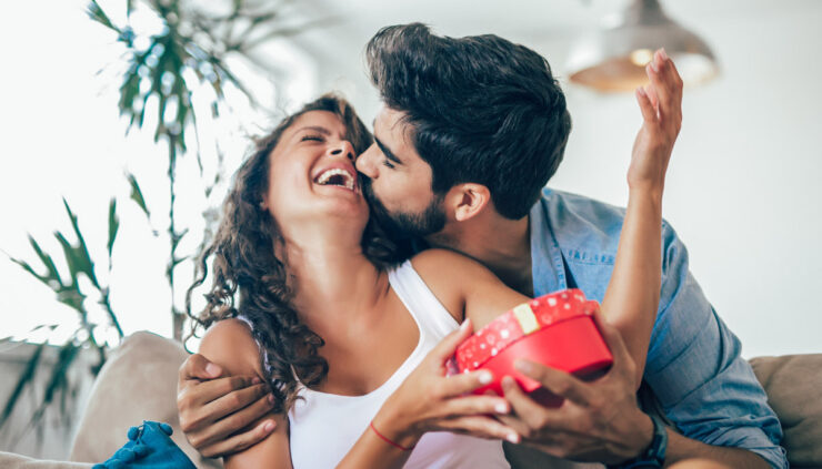 Man giving woman gift on Valentine's Day