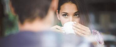 Woman flirting drinking coffee