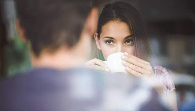 Woman flirting drinking coffee