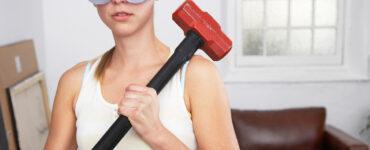 Woman holding sledgehammer
