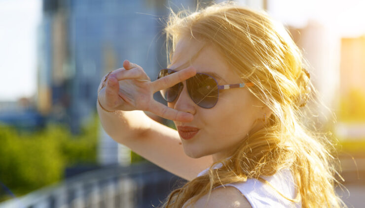 Blond girl in sunglasses